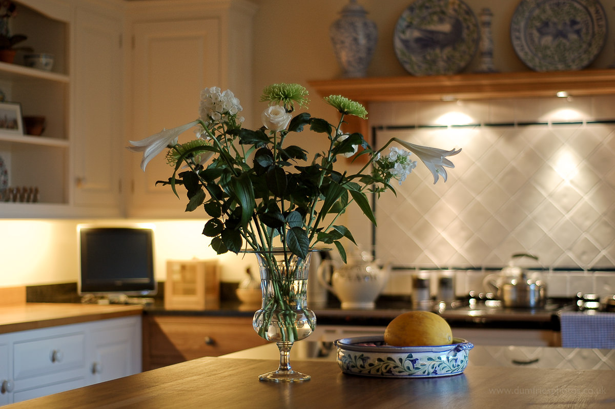 Vase of flowers in country kitchen