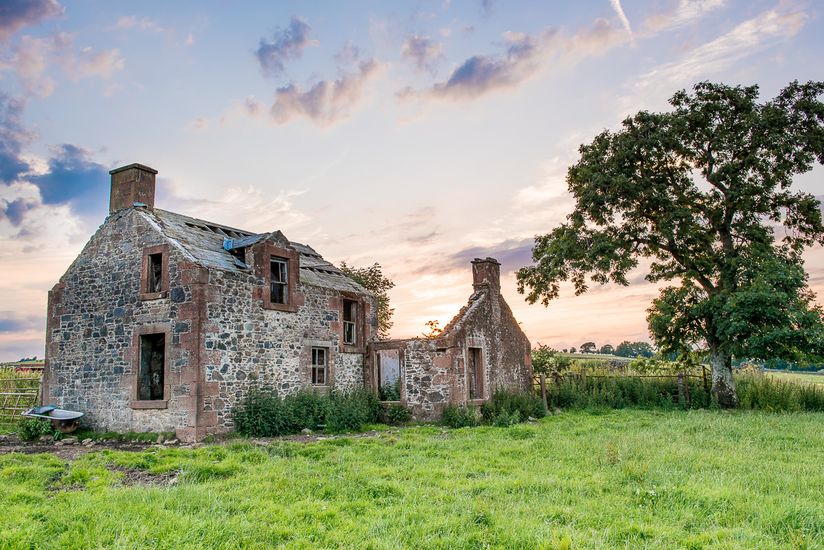Old farm building at sunset